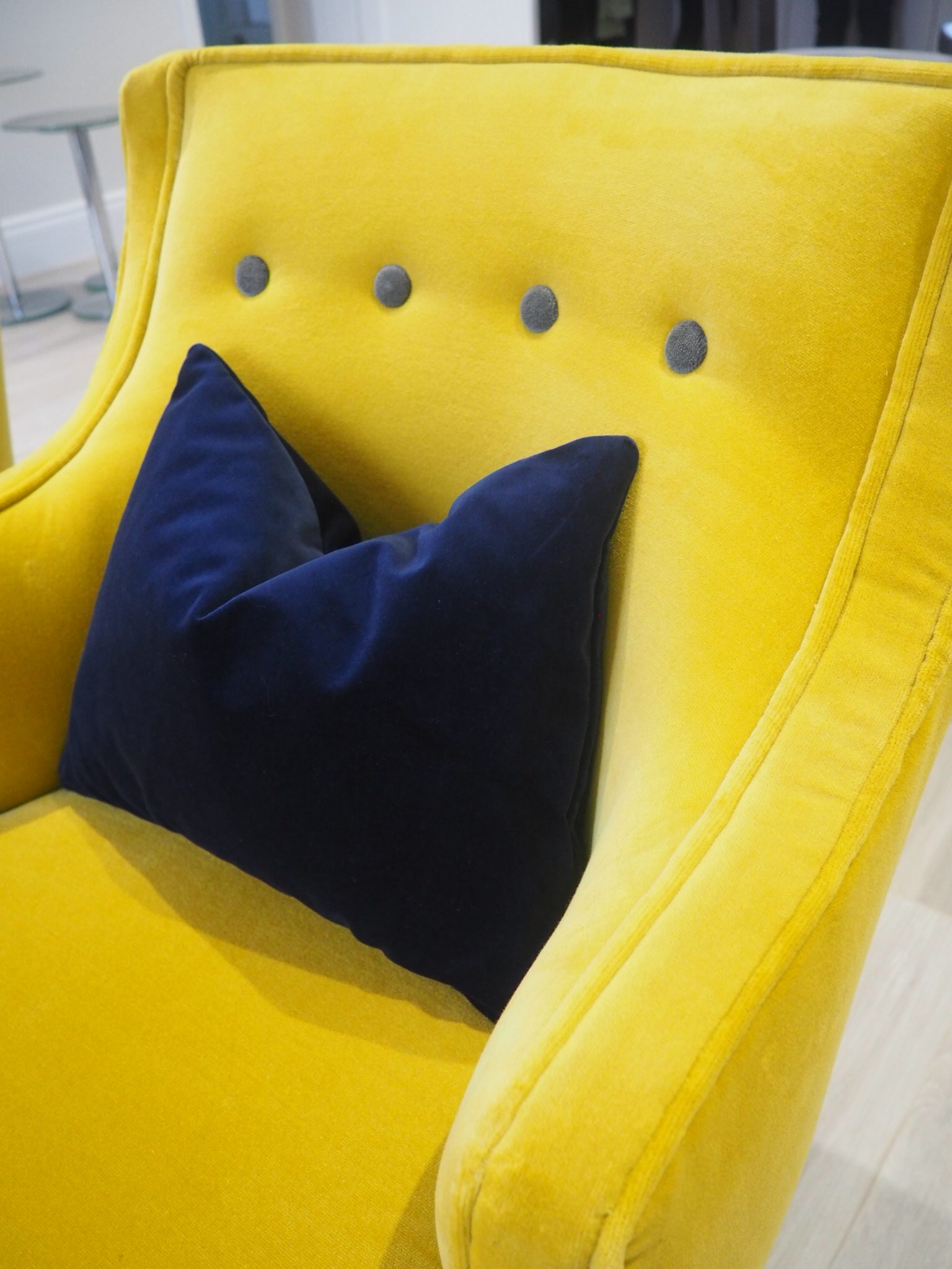 Mustard chair by Atkin and Thyme with a navy velvet cushion