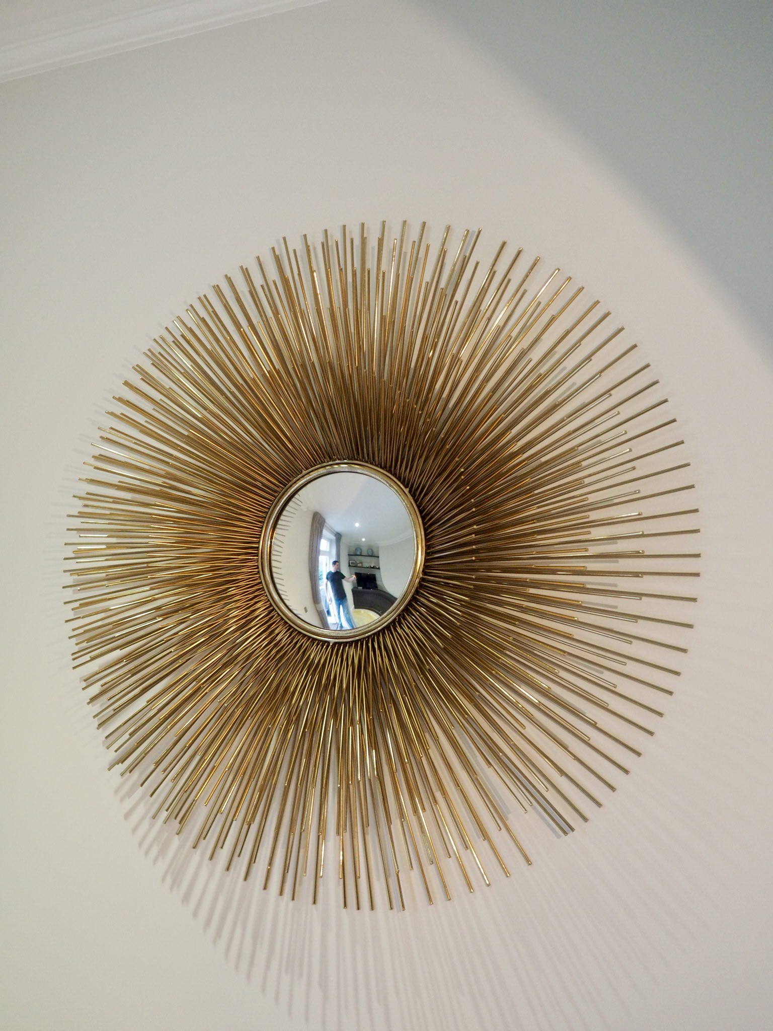 Gold Porcupine Mirror with three levels of prongs