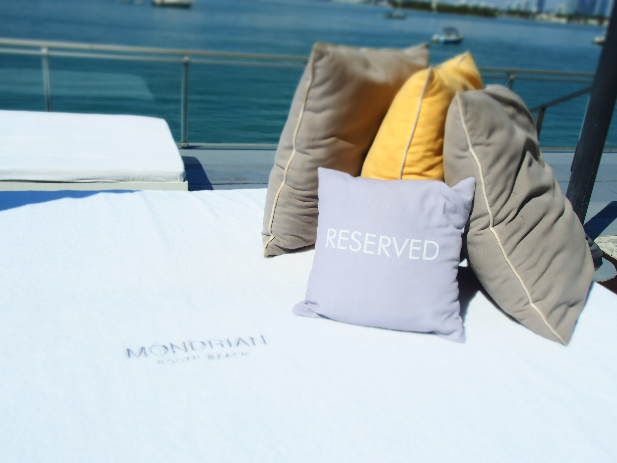 Sun lounger with Mondrian Hotel cushions with the Biscayne Bay in the background Miami