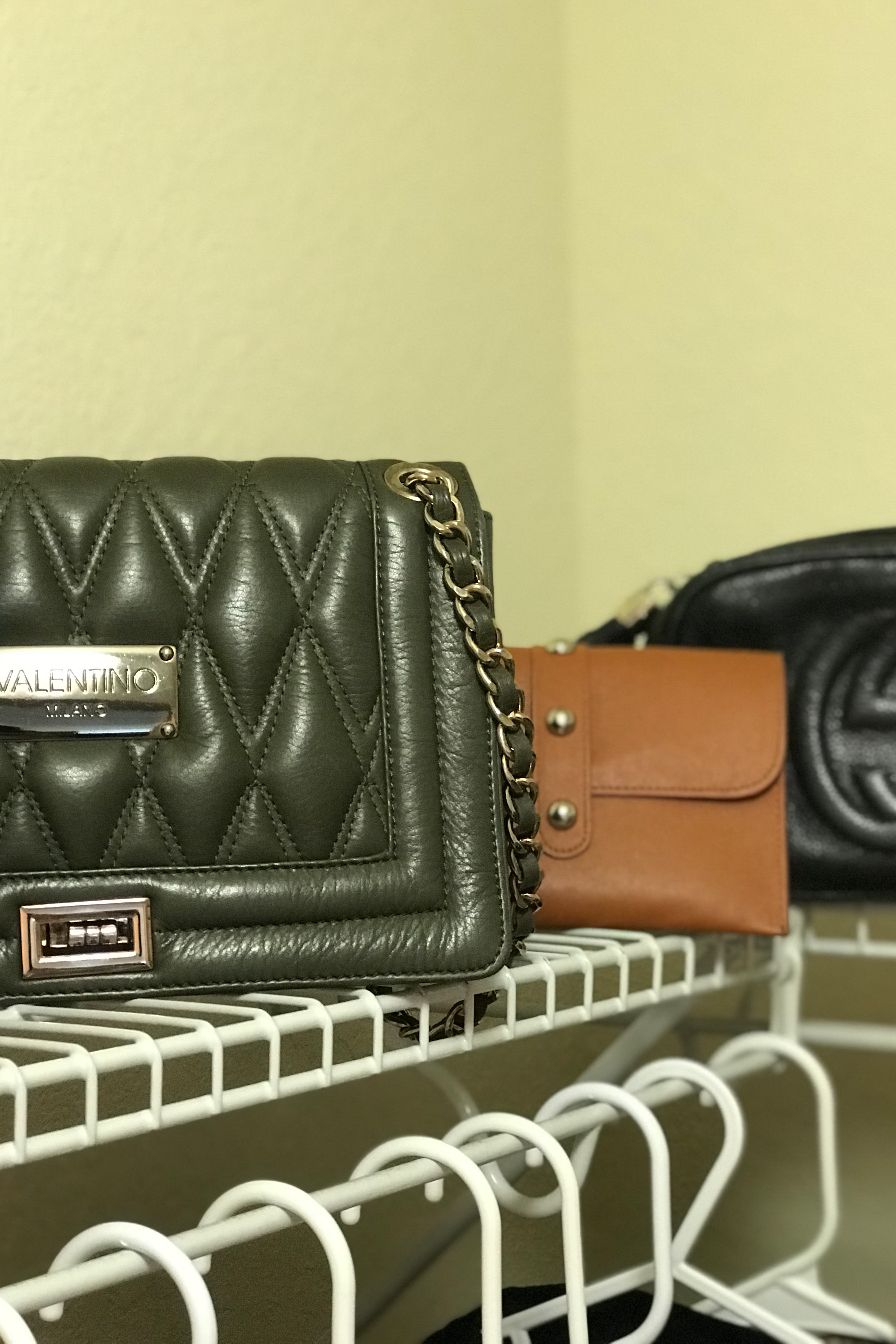 Selection of handbags and belt purses bags by Valentino , Gucci, Prad and Misspap