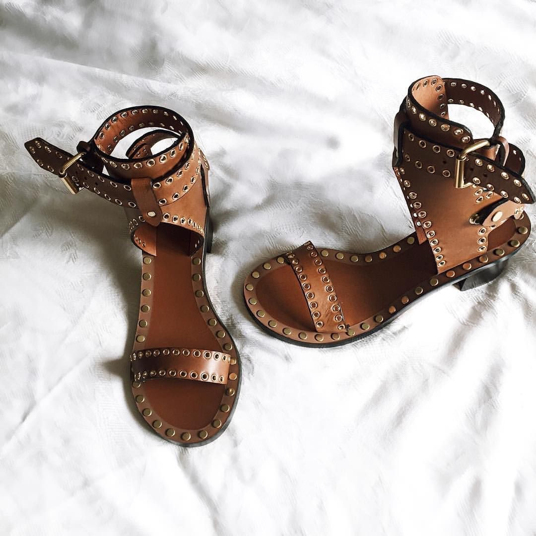 Isabel Marant Vegetal sandals in tan leather on a messy bed