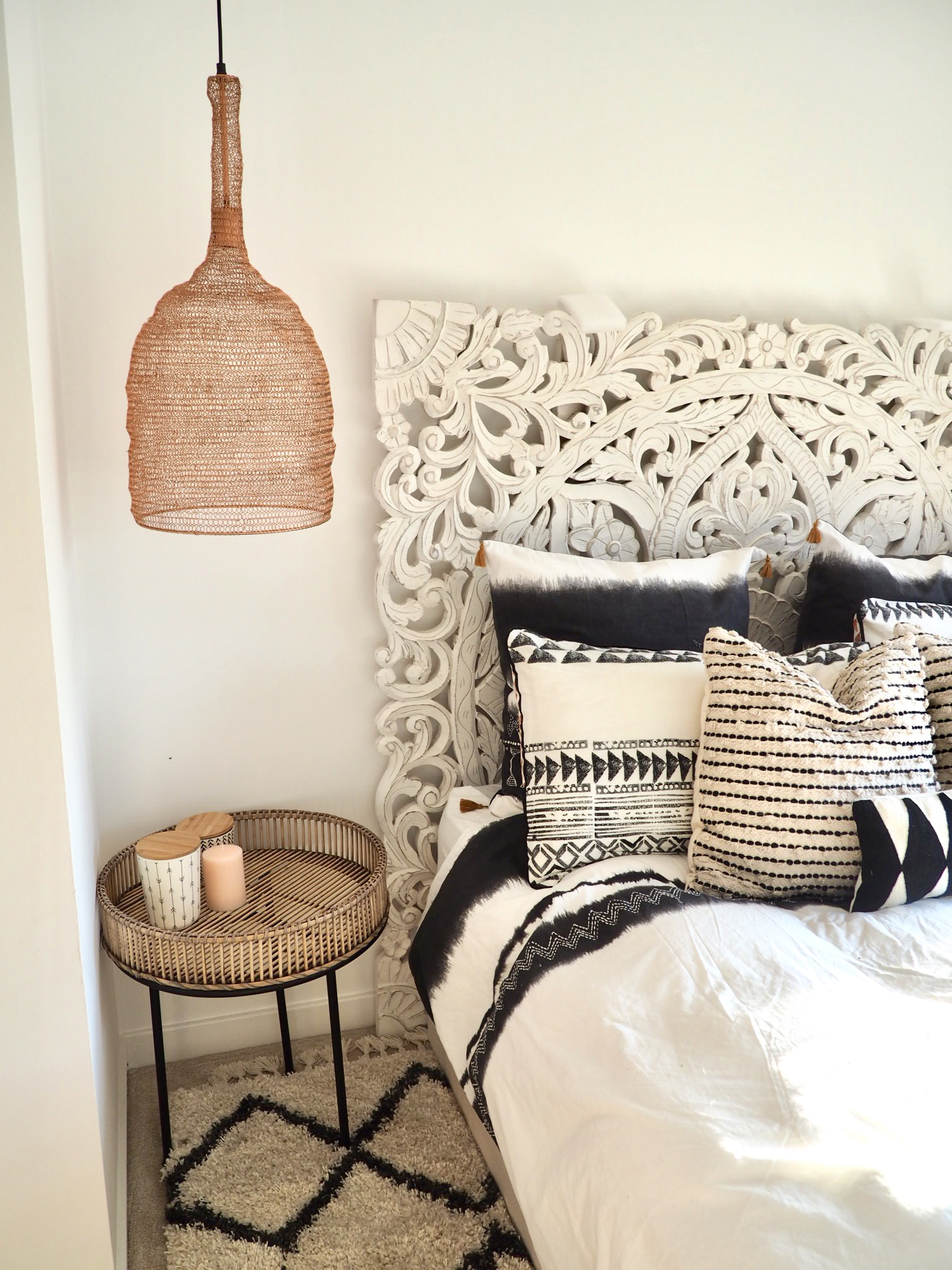 Bedding from La Redoute next to copper mesh pendant lights