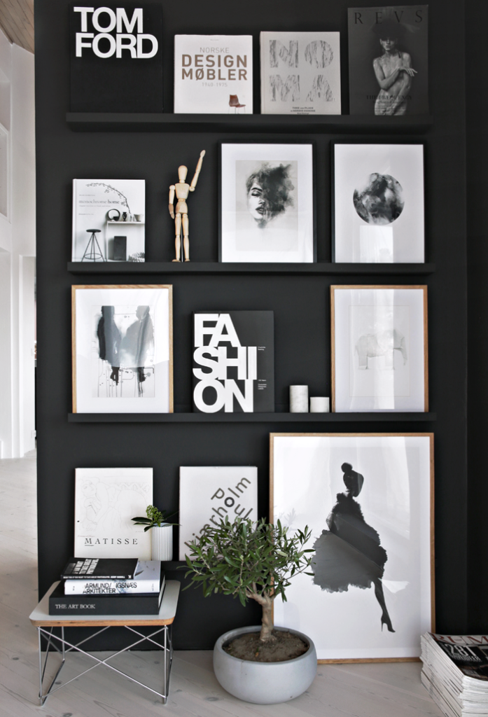 Black feature wall with shelving and art and curios